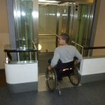Picture showing a wheelchair user entering the lift