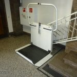 Picture of the stair lift at the foot of the stairs.