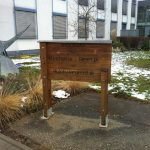 Wooden sign indicating the entrance